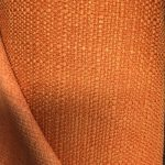 Møbelstoff med linstruktur orange