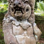 One of the many stone guardians surrounding Tirta Empul.