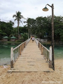 Bridge to one of the many resorts at Patar White Sand Beach