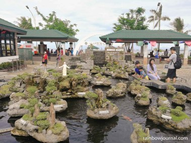 The Hundred Islands Koi and Bonsai garden at Lucap Park is a miniature version of the National Park