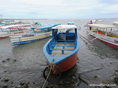Colorful boats docked at Lucap Wharf