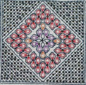 Closeup of beaded blackwork unit