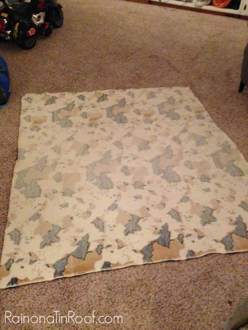 Faux Cowhide Fabric - lay on ground.