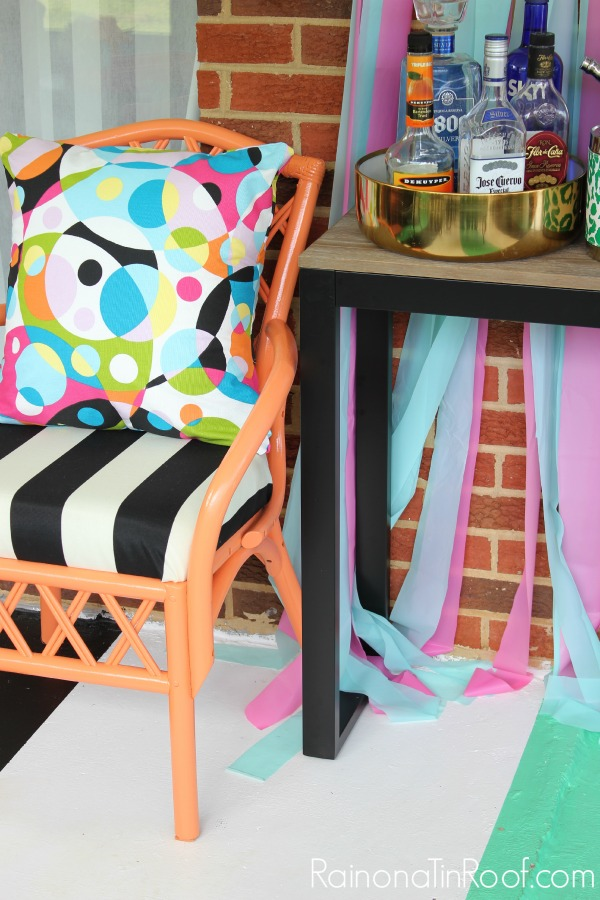 Colorful Porch Makeover (because I like to drink cheap beer in colorful places) via RainonaTinRoof.com #porch #outdoors #porchdecor #diy #decorating