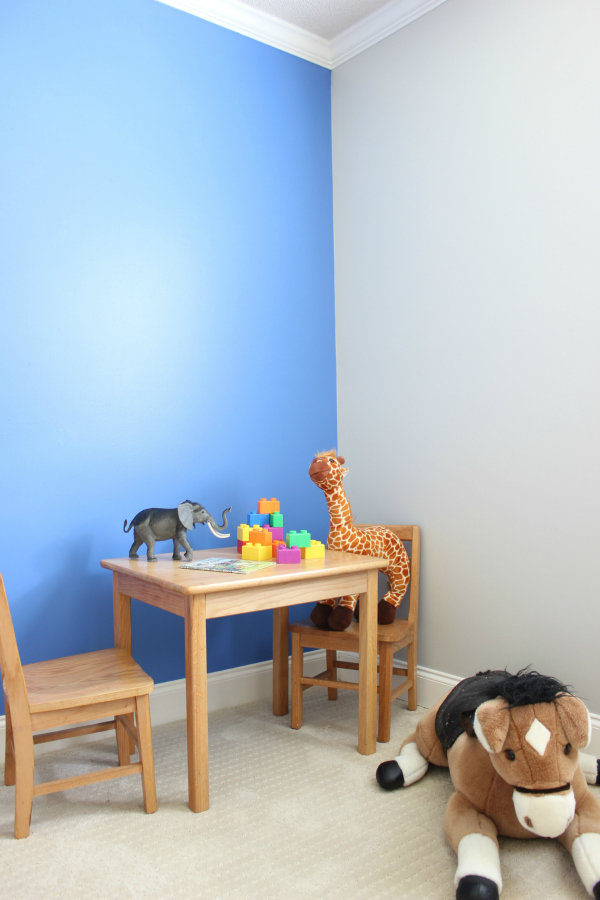 create an accent wall by painting one wall only - blue feature wall against gray walls