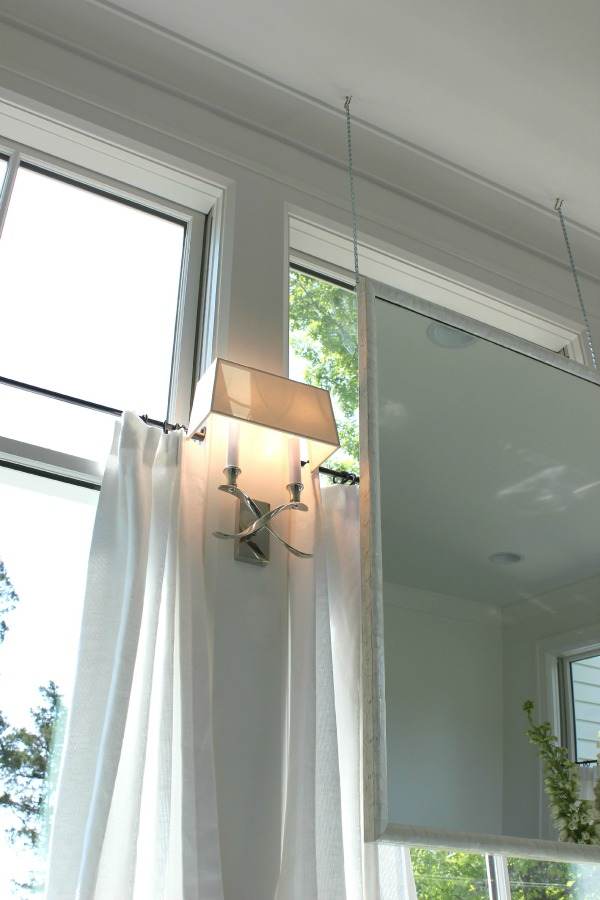 Hang your mirrors from the ceiling instead of the wall.