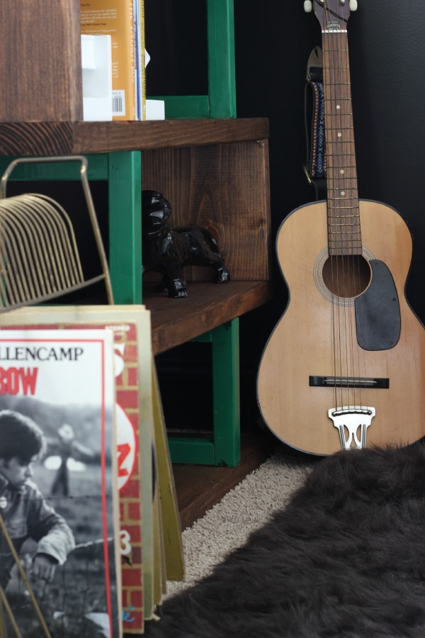 DIY Rustic Modern Bookshelf Build - guitar beside bookshelf - Rain on a Tin Roof