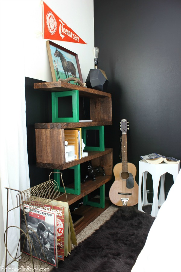 Masculine Bedroom Makeover - This room functions as a Guest Room, Teenage Boy's Room, and an Office. Lots of great ideas for making a room function for multiple uses. DIY Bookshelf / Guitar as decor