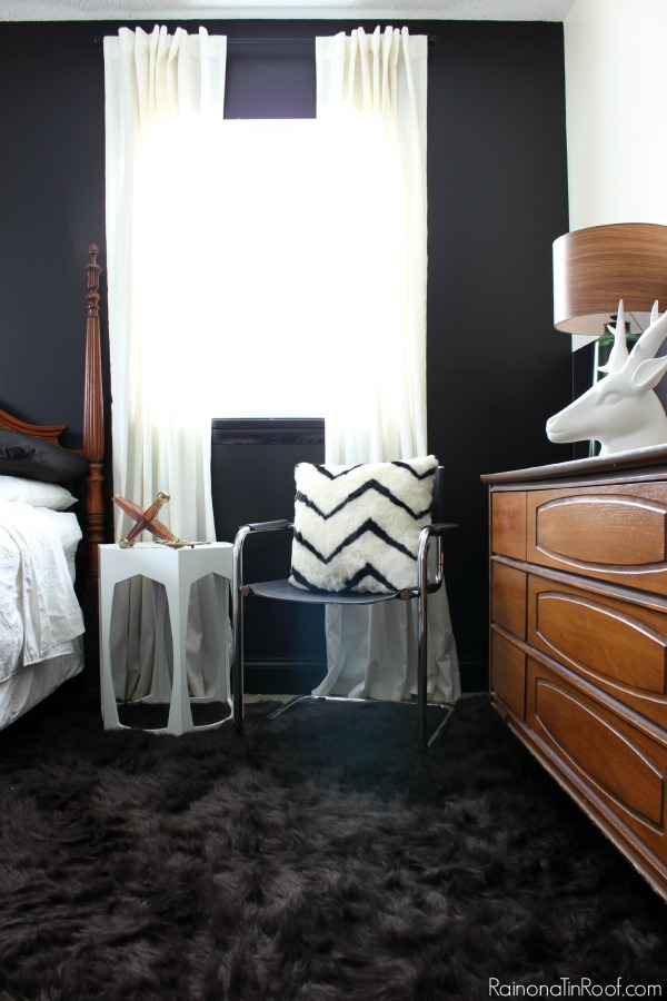 Masculine Bedroom Makeover - This room functions as a Guest Room, Teenage Boy's Room, and an Office. Lots of great ideas for making a room function for multiple uses. Vintage Mid-Century Modern Dresser / Faux Brown Fur Rug / Black and Leather Chrome Chair / Fur Accents / White Geometric Table / Oversized Jack Decor