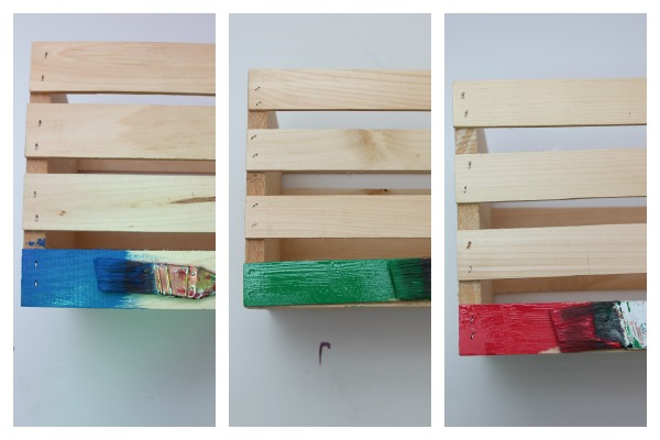 how to make a toy wagon out of crates - painting crates red, blue and green.