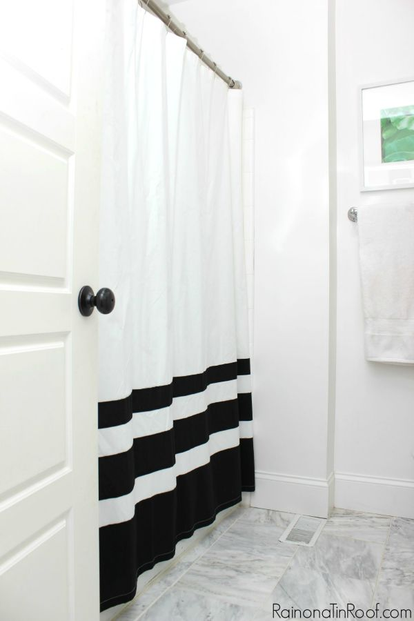 Spring Home Tour: The Evolution of Style   White Bathroom Makeover with a Pop of Green   Black and White Bathroom