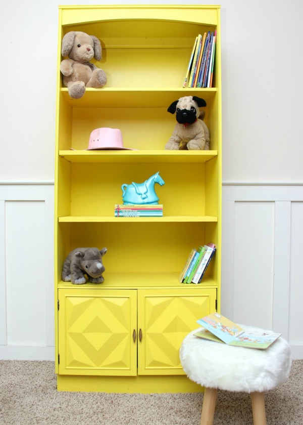 She used a paint sprayer to paint this piece of furniture and it looks so simple! Yellow Bookshelf Makeover   Furniture Makeover   Furniture Painting