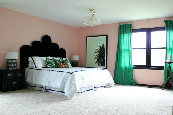 Well Traveled Master Bedroom Makeover Reveal - DO NOT miss this master bedroom! It combines bold black and white, a touch of green, pink and a dash of Palm Beach! STUNNING! Lots of great DIY project ideas for bedrooms in this article! DIY Headboard / DIY Huge Ass Picture Frame / Palm Beach Design / Kelly Green Curtains / Palm Leaves Decor / Banana Leaves Decor / Velvet Upholstered Headboard