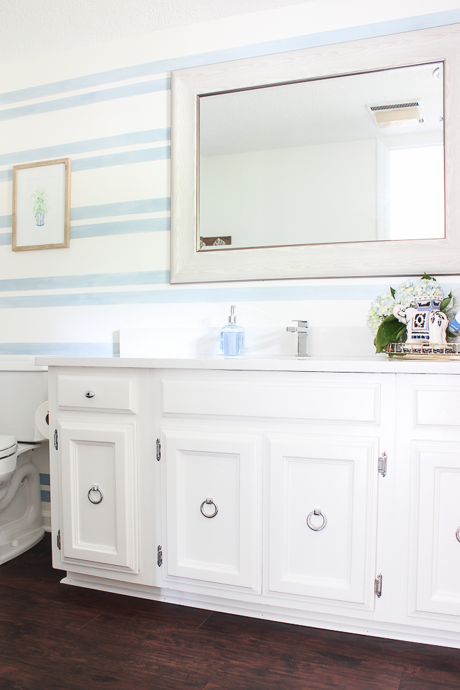 Wall designs with tape - blue and white stripes in a bathroom