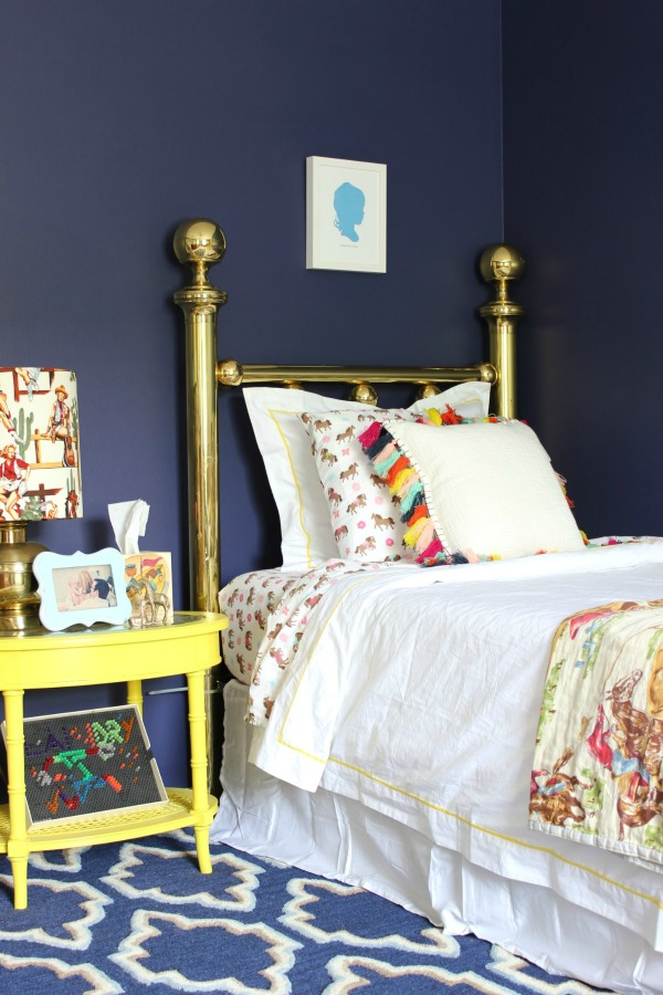 Such a perfect kid's room - not too babyish, but not too grown up. Will grow well with the child! LOVE all the color! A must-see! The 70's Landing Pad Home Tour, Part 2: The Circus' Room | Kid's Bedroom Ideas | Vintage Brass Bed | Pops of Color in the Decor
