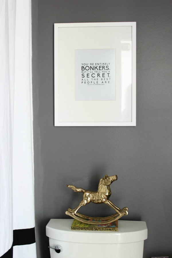 Such an adorable bathroom for a kid, but also stylish for adults! The 70's Landing Pad Hall Bathroom | Gray Walls / Black and White Decor / Kid's Bathroom
