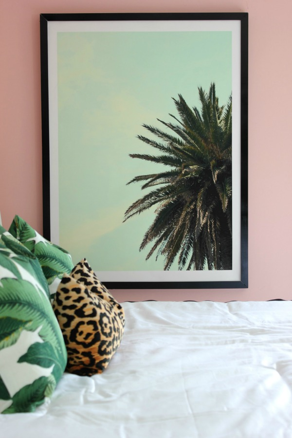 This master bedroom makeover is a MUST-SEE! Who knew pink could look so good?! It's an eclectic vibe of old Hollywood glamour meets Palm Beach decorating styles! The 70's Landing Pad Home Tour, Part 2: The Master Bedroom | Palm Tree Art