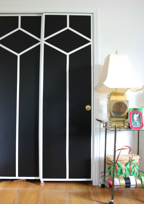 Great ideas for incorporating family trinkets and treasures into your decor! The 70's Landing Pad Office Tour: Full of family treasures and trinkets, but decorated tastefully and with a touch of flair. | Black and White Painted Closet Doors