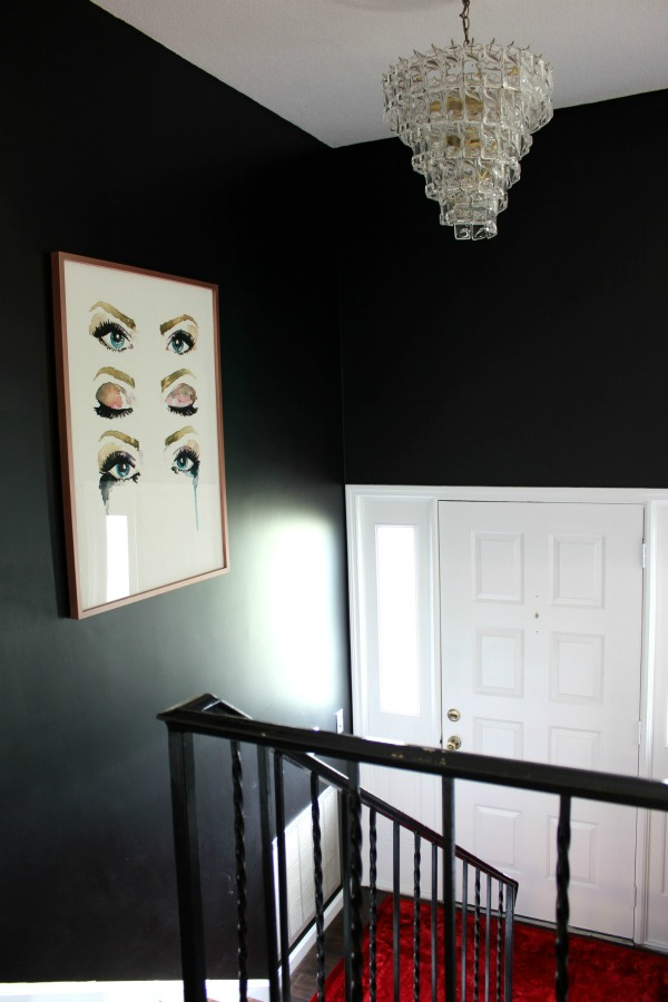 If you love black walls and dramatic interior design, you have to see this entryway makeover! It's full of deep moody colors and breathtaking art! Dramatic Entryway Makeover | Black Walls | All White Door | Soul Seeing Art via Minted