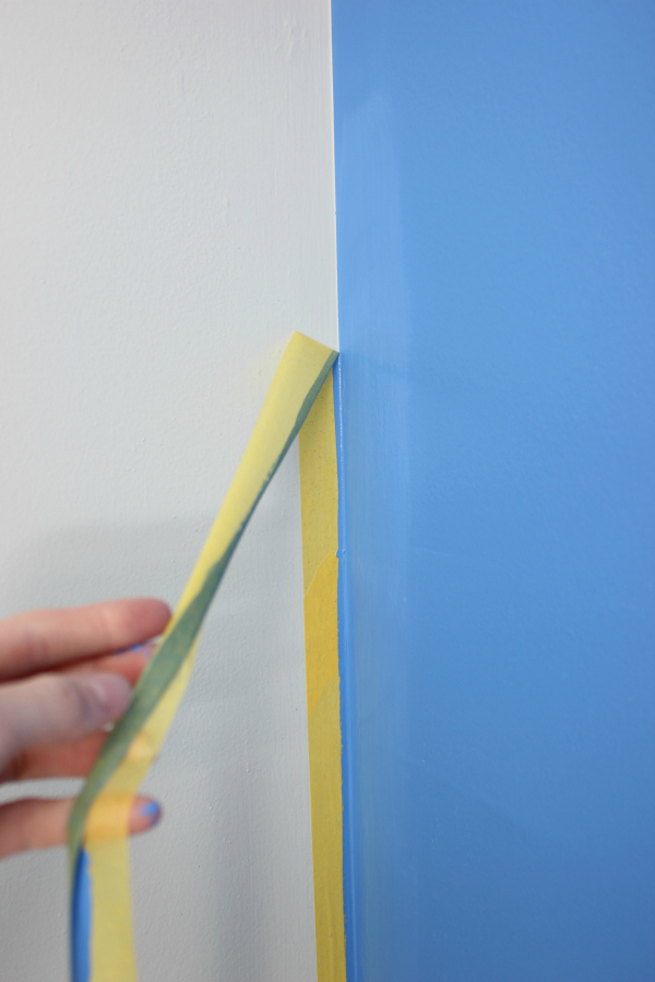 Remove the FrogTape. Tutorial for a Simple Blue Accent Wall using Behr's Boat House - great idea for adding a little color to a room!