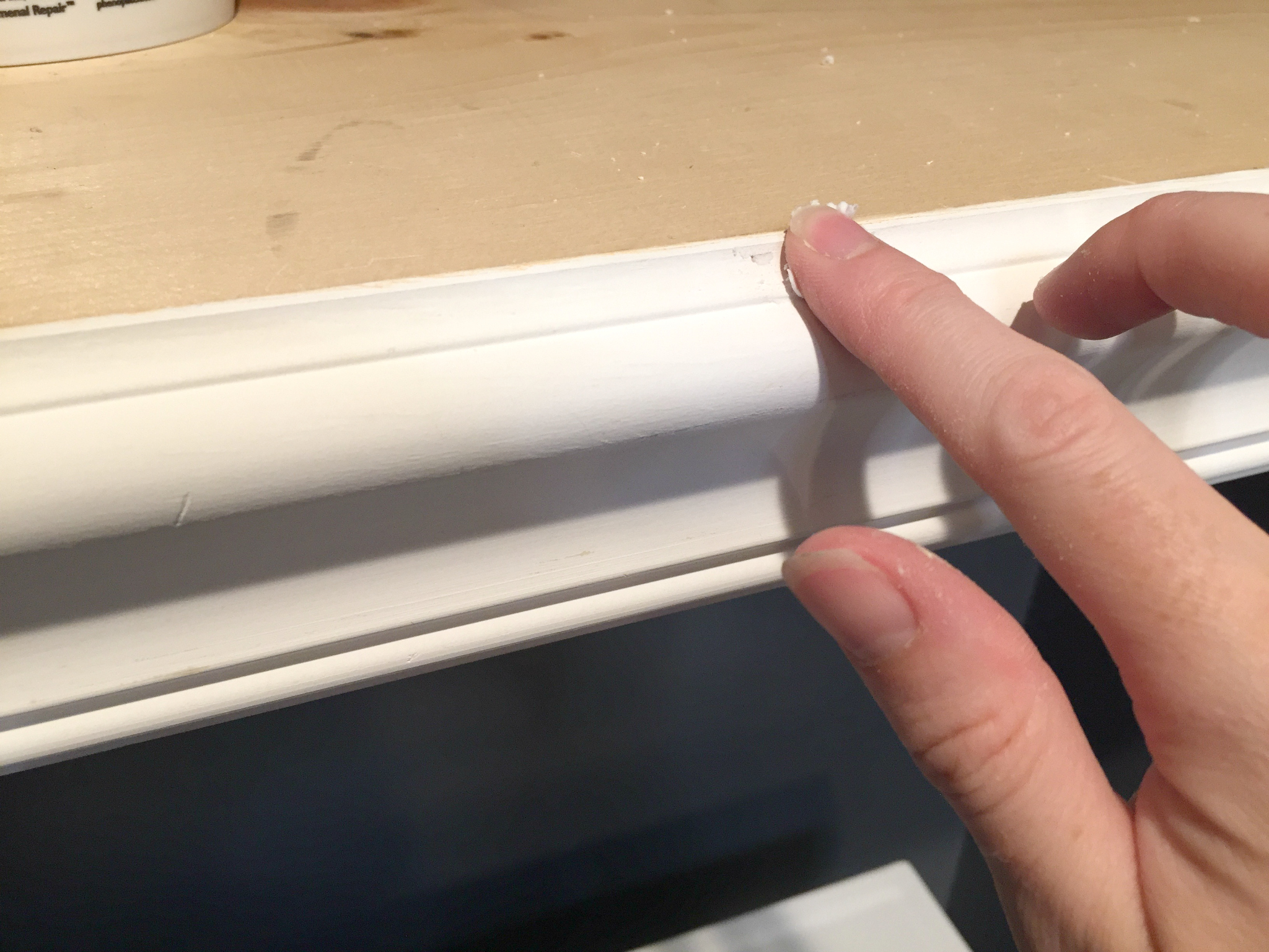 How to Paint Trim and Doors: Fill nail holes with spackling.