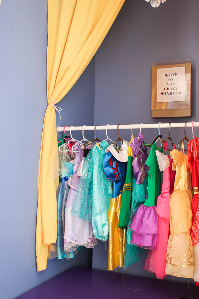 How to Build a Stage with Hidden Dress-Up Clothes Storage - curtain hiding clothes - Rain on a Tin Roof