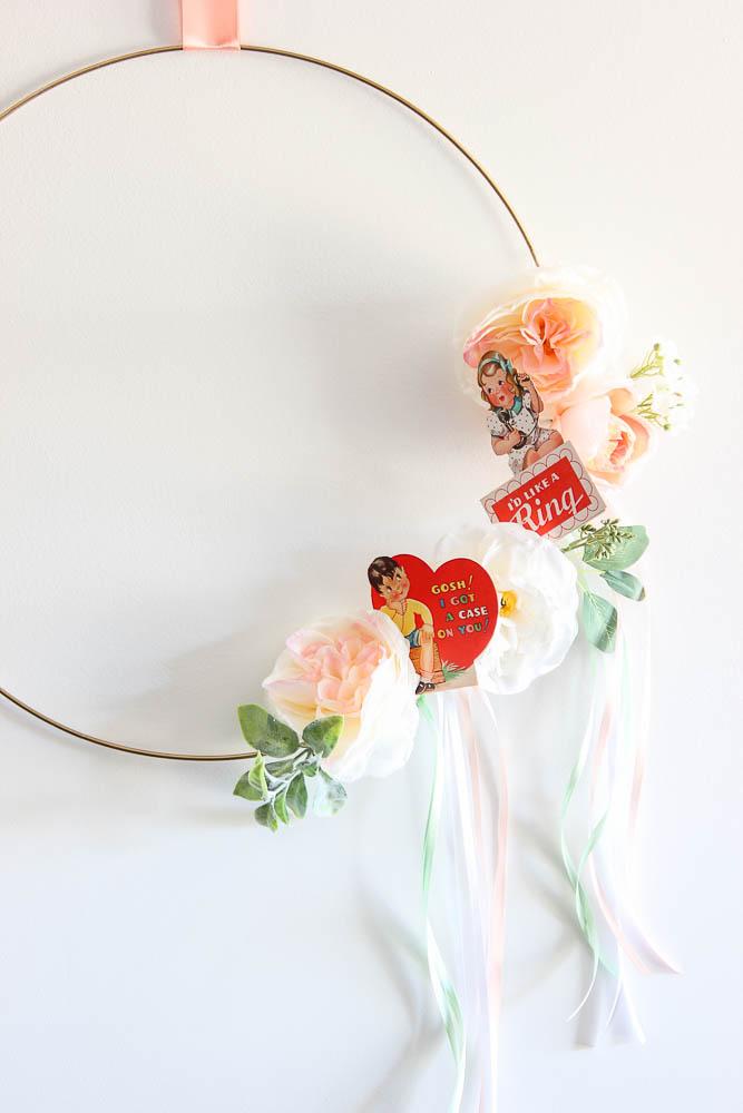 Simple Valentines Wreath DIY with flowers and vintage valentines.