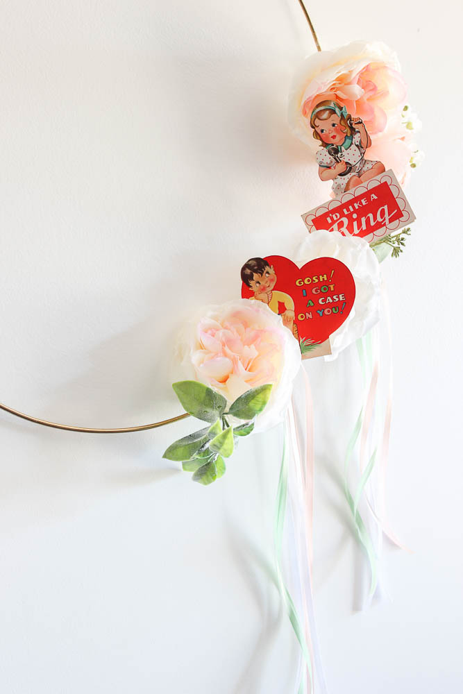 valentine day wreath ideas with ribbon, flowers and valentine cards.