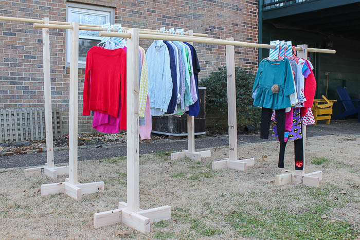 How to Hang Clothes at a Garage Sale - clothes on racks - Rain on a Tin Roof