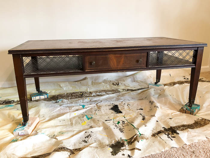 Take an old coffee table and turn it into an ottoman type coffee table.