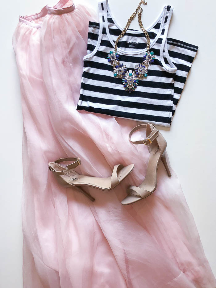 long pink skirt and black and white tank top from thredUP review