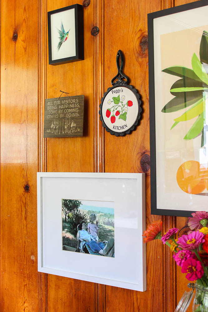 Pine Paneling in a Kitchen - using colorful art to decorate it - Rain on a Tin Roof