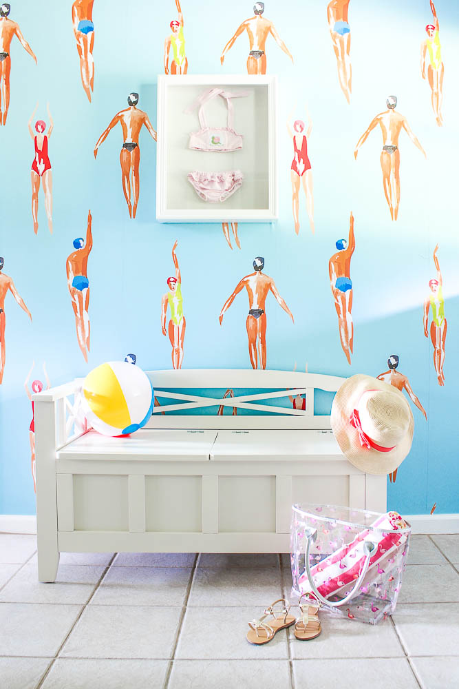 Mudroom Laundry Room Makeover using colorful swimming wallpaper.