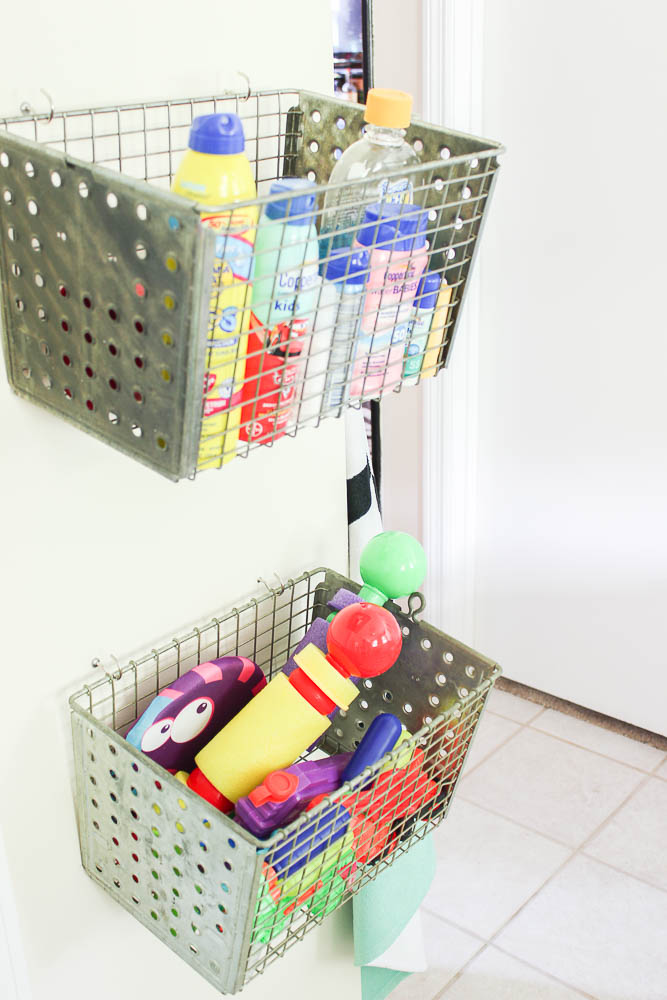 Mudroom Storage Ideas - vintage locker baskets mounted on wall for storage.