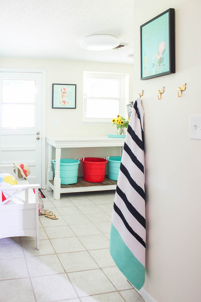 Mudroom laundry room - beige walls, bright pops of color.
