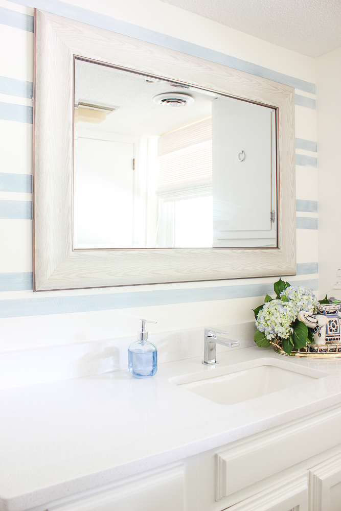 Bathroom Accent Wall with Washed Out Blue Stripes