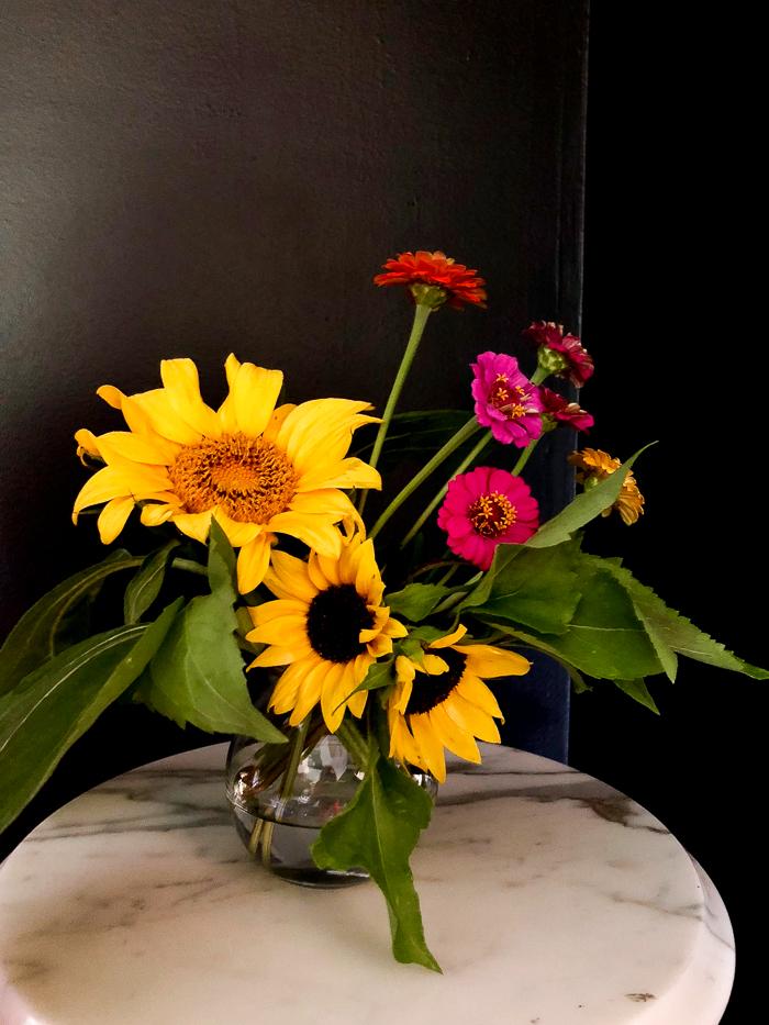 Creating flower arrangements from a cut flower garden.