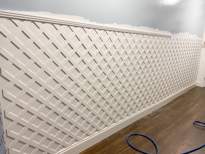 DIY Indoor Lattice Wall - installing a molding cap on top of the lattice.