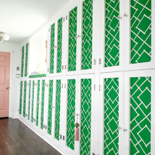 Mudroom cabinets with green and white lattice fabric panels.