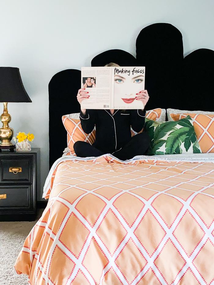 Orange bedding with DIY black velvet headboard.