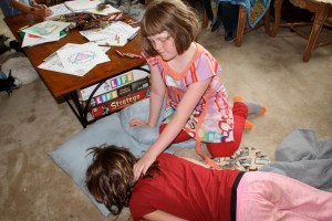 Kaia helping Allie with a sore neck.  Reiki heals on all levels, physical, emotional, mental and spiritual.
