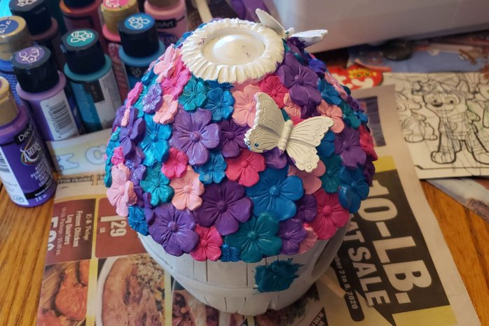 Front/side view of my painting work-in-progress flower barrel birdhouse with butterflies