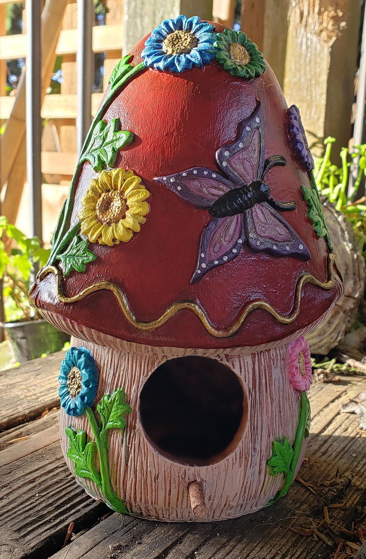 Finished painting of the mushroom birdhouse