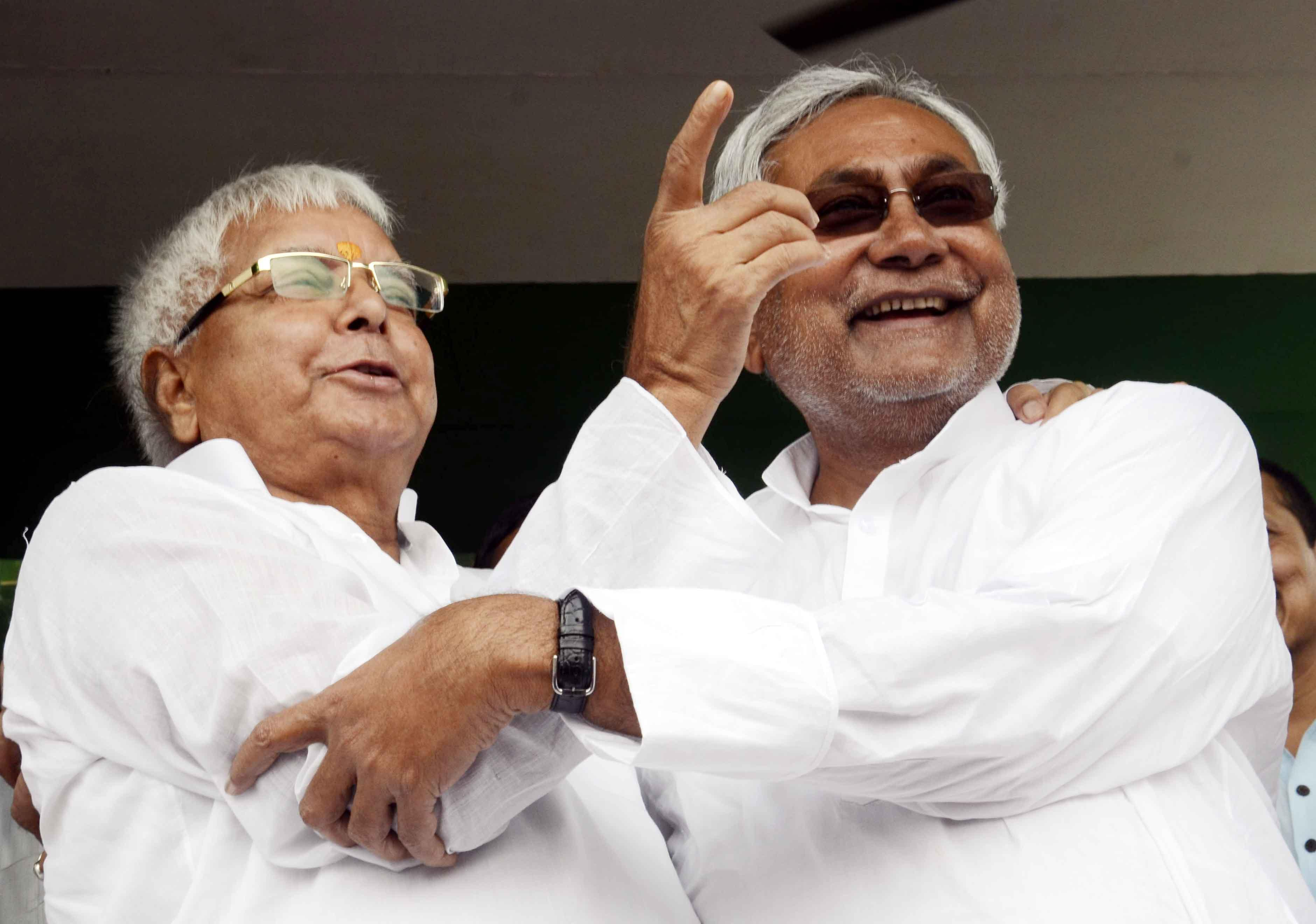 Former Chief Ministers of Bihar, RJD chief Lalu Prasad Yadav and JD-U leader Nitish Kumar during a rally in Hajipur of Bihar on Aug 11, 2014. (Photo: IANS)