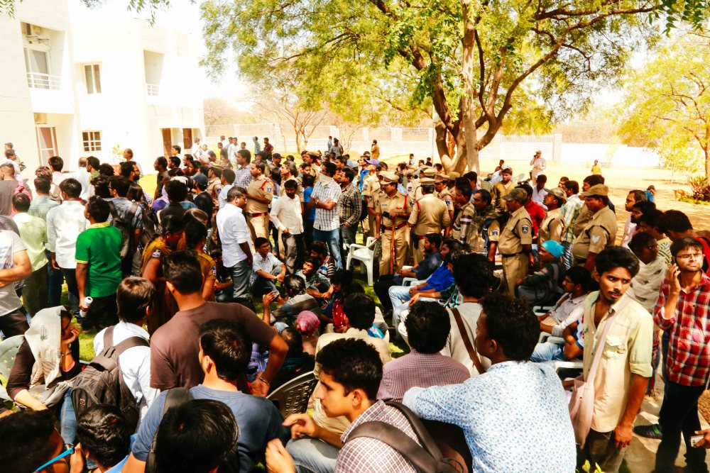 Students raising slogans against BJP and the state police