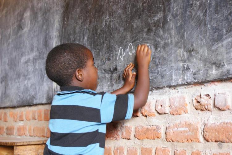 A boy writes on the blackboard in Burundi. Credit: UNICEF Burundi