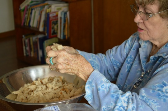 Granny tearing up the bread for the dressing