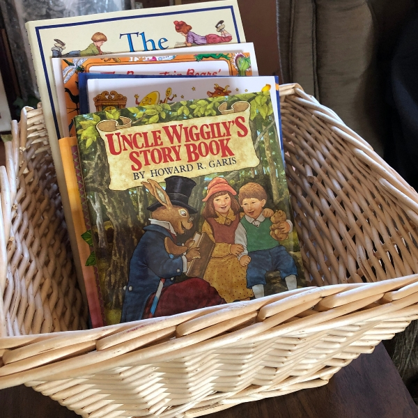 Introduce your children to living books by gathering a basket full of lovely books for them to read and delight in during the lazy summer afternoon hours!
