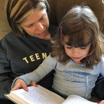 Reading aloud to my daughter.