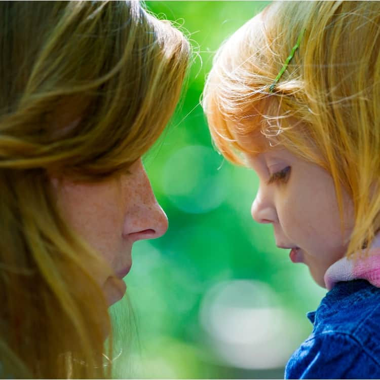 Speaking softly can get your kids to hear you so you stop yelling at your kids